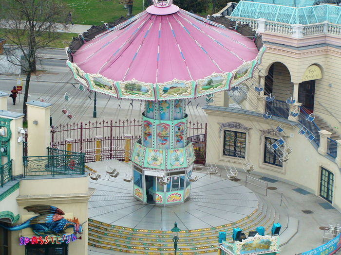 Amusementpark Architecture Art Art And Craft Building Exterior Built Structure Creativity Culture Cultures Flying Flying Swings From My Point Of View From Where I Stand Having Fun High Angle View Human Representation Ornate Sculpture Spining Wheel Spinning Statue View From Above Pastel Power