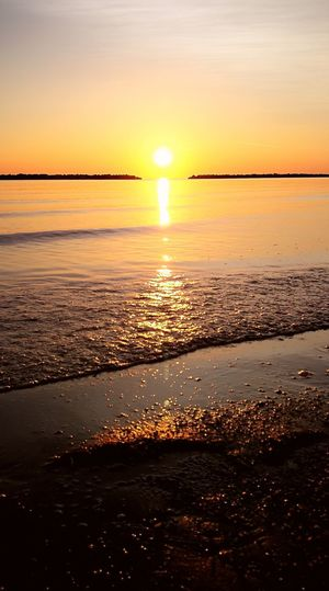 Sunset Sea Sun Scenics Orange Color Beauty In Nature Nature Horizon Over Water Reflection Beach Sky Sunlight Water Tranquil Scene Dramatic Sky Tranquility Outdoors Silhouette Summer No People