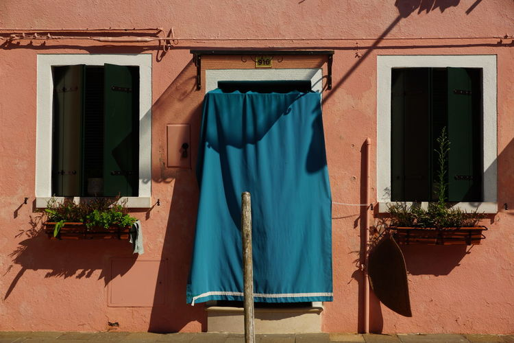 Textile hanging on door of house