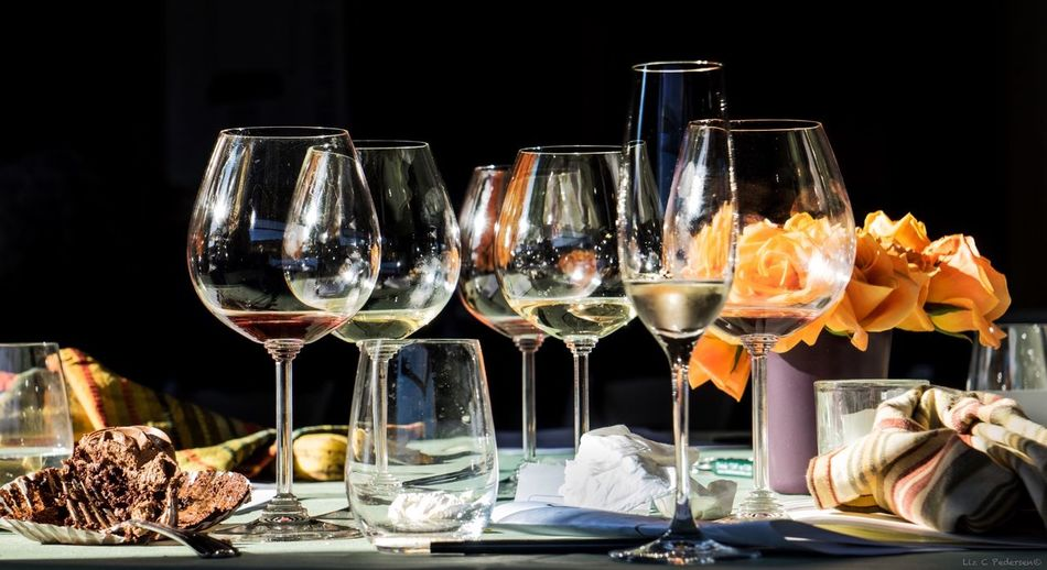 Wine in drinking glass and food on table at restaurant