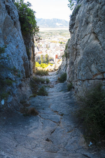 Footpath amidst rocks and trees
