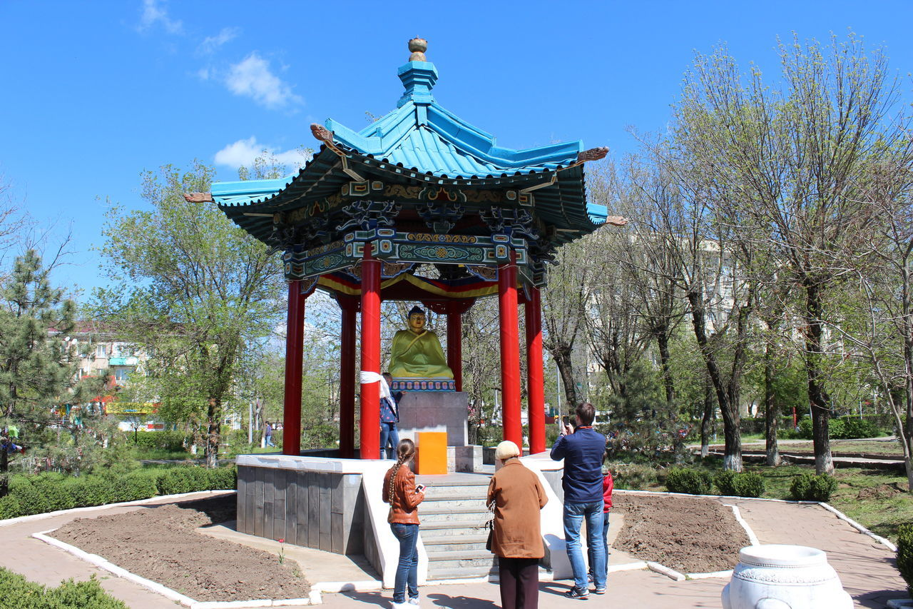 Rear View Of People Standing Outside Shrine At Park