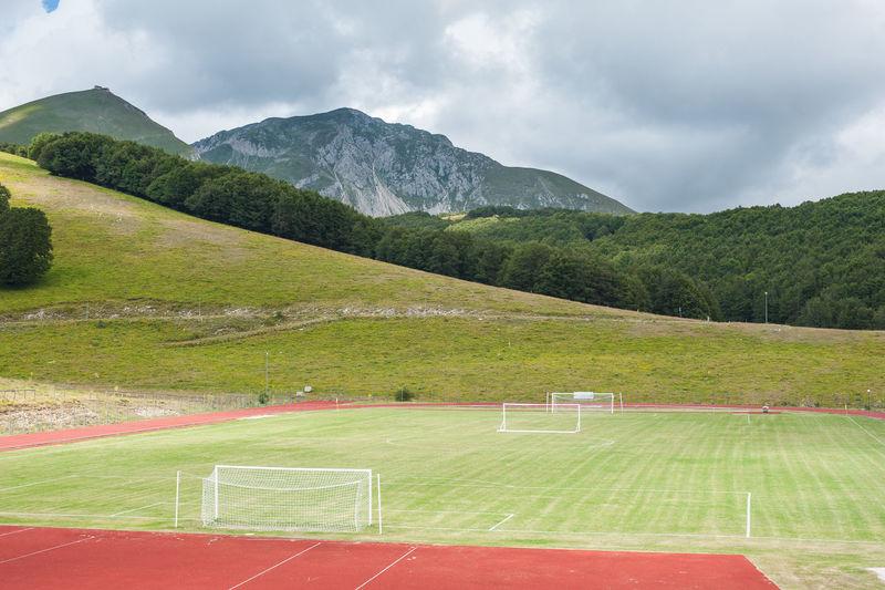 Soccer field in mountain landscape