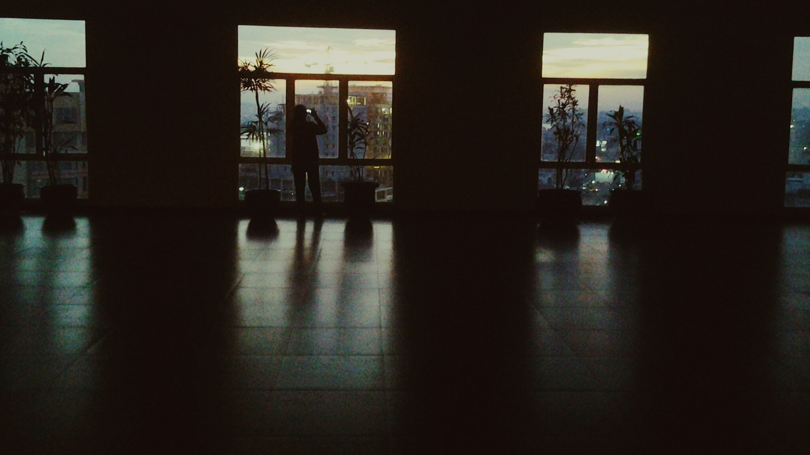 indoors, window, glass - material, architecture, built structure, transparent, flooring, corridor, reflection, door, day, sunlight, architectural column, tiled floor, curtain, home interior, shadow, empty, silhouette, closed
