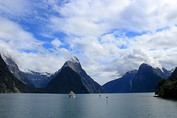 Milford Sound Beauty In Nature Cloud - Sky Day Idyllic Lake Mode Of Transportation Mountain Mountain Range Nature Nautical Vessel Non-urban Scene Outdoors Real People Scenics - Nature Sky Tranquil Scene Tranquility Transportation Water Waterfront