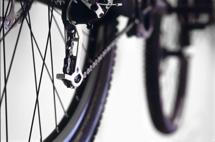 details of a black mountainbike Bicycle Bike Breaks Chain Cross Derailieur Derailleur Deralier Design Detail Downhill Focus On Foreground Mechanic Mechanism Metal Mountaincross Moutainbike Nobble Rear Mech Rubber Selective Focus Tread Tyre Wheel