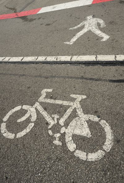 Roadsigns for bycicles and people Asphalt Bicycle Lane Bycicle City Communication Day Guidance High Angle View Human Representation Information Information Symbol Marking No People Outdoors Representation Road Road Marking Road Sign Sign Street Symbol Transportation Walking Path White Color