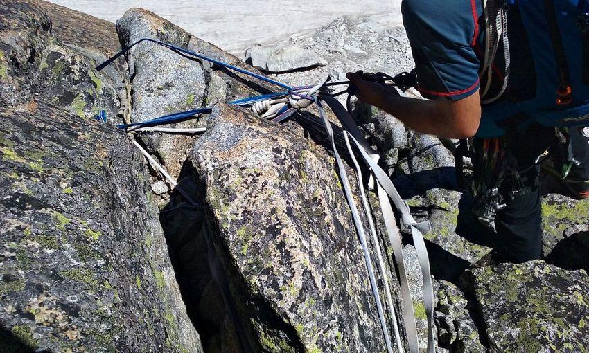 Close-up of man rock climbing