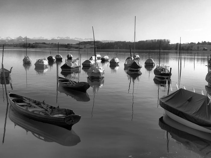 Boats moored in lake