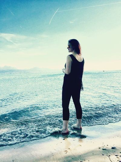 Sea Beach Horizon Over Water One Person Standing Full Length Water Sky Nature Tranquil Scene Beauty In Nature Scenics Young Adult Vacations Tranquility Sand Outdoors Young Women Leisure Activity Real People Lausanne Switzerland