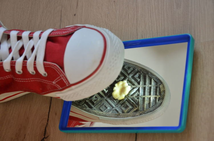 Shoe over mirror with chewing gum on the shoe sole Shoe Sole Mirror Shoe Anger Annoying Below Bottom Chewing Gum Close-up Dirt Floor Furious Indoors  Irritating No People Pattern Red Color Upset White Color