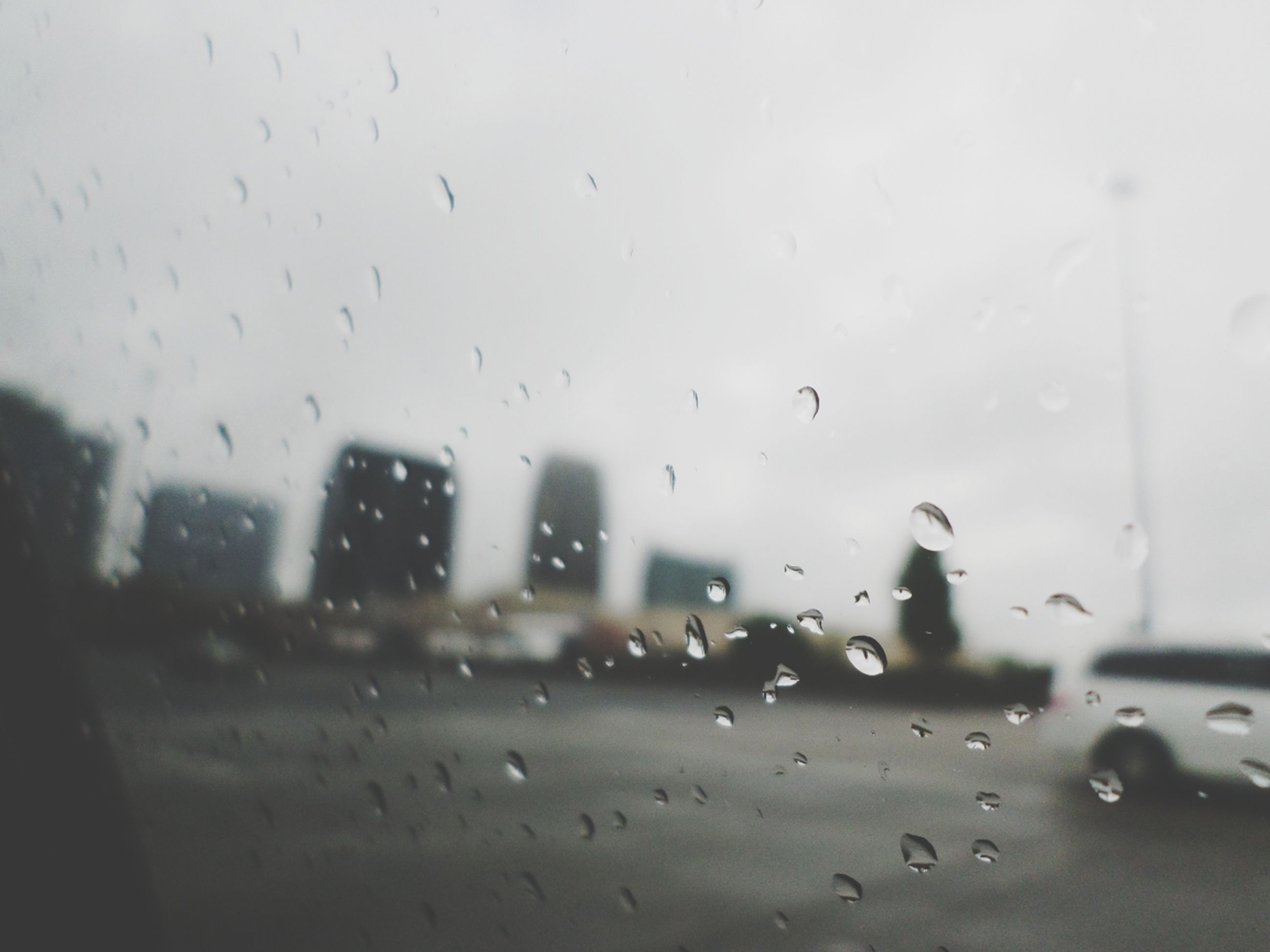 drop, wet, window, rain, indoors, glass - material, transparent, water, weather, raindrop, season, glass, car, built structure, transportation, monsoon, focus on foreground, architecture, sky, no people