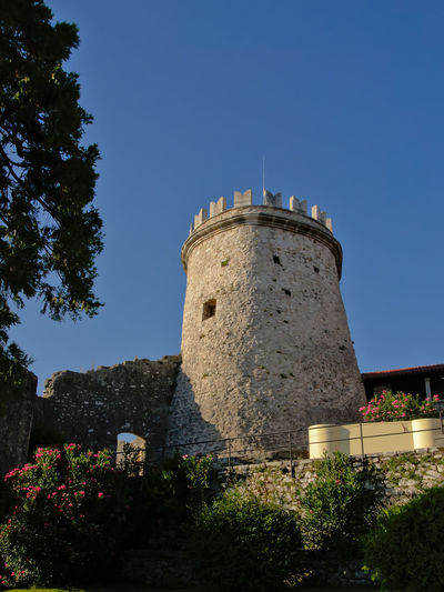 Lookout tower of Trsat castle in Rijeka, Croatia, on a sunny day with clear blue sky Architecture Rijeka Tourist Attraction  Architecture Brick Building Building Exterior Castle Clear Sky Coratia Defensive Fort Fortification Historical History Landmark Low Angle View Medieval Tourism Tower Travel Destinations Trsat