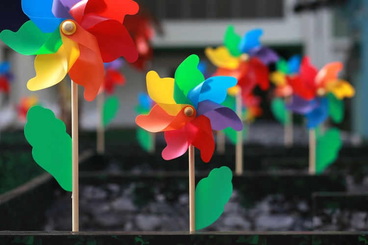 Pinwheel Architecture Art And Craft Blue Built Structure Close-up Craft Creativity Day Focus On Foreground Multi Colored Nature No People Outdoors Paper Pinwheel Toy Selective Focus Toy Variation Yellow