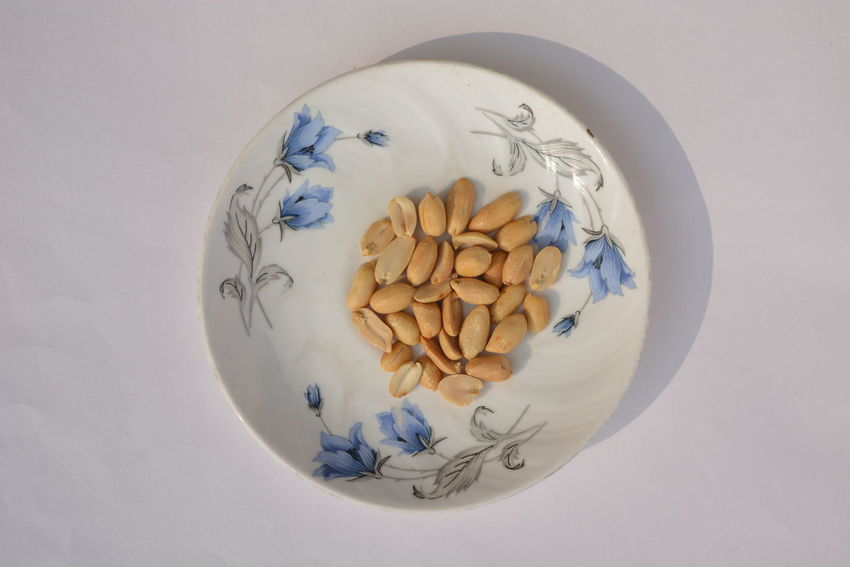 Peanuts in a designer plate From Above  Nuts Peanuts Ceramic Ceramic Material Ceramic Plate Close-up Day Design Designer  Designer Plate Fat Rich Food Food Food And Drink Food On A Plate Food Photography Freshness Glass Glass Material Groundnut Groundnuts Plate White Backdrop White Background White Backround