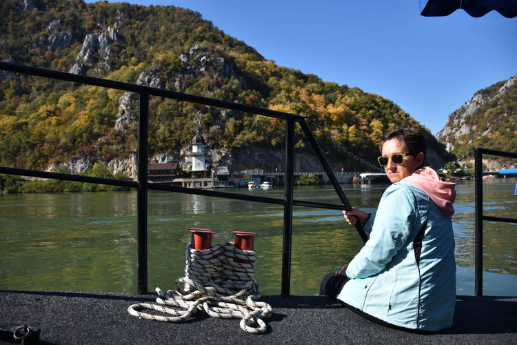 Danube gorge, Serbia Water Real People One Person Nature Looking At Camera River Portrait Lifestyles Leisure Activity Transportation Day Mountain Sitting Outdoors Woman Mature Adult Ship Rope Fence Sunglasses