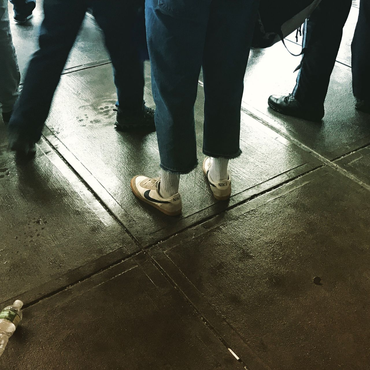 low section, human leg, standing, shoe, real people, human foot, men, indoors, day, human body part, lifestyles, togetherness, adult, people