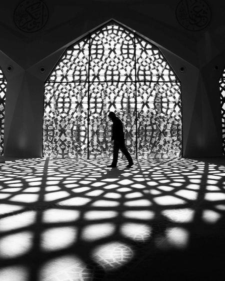 Full length of boy walking in corridor