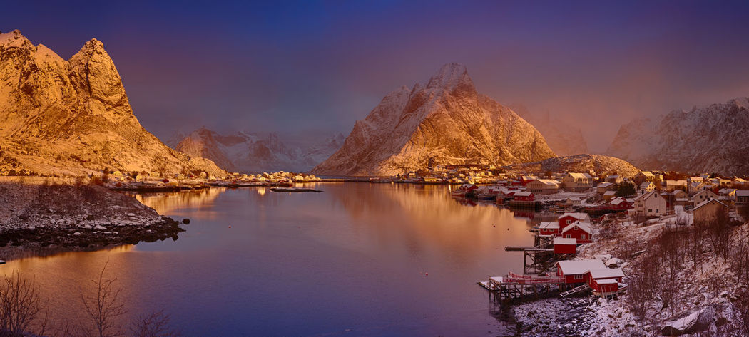 Village of Reine in Norway at sunrise. A much larger version of this image is available upon request. Fishing Village Norway Reine Arctic Beauty In Nature Idyllic Lake Lofoten Mode Of Transportation Mountain Mountain Range Nature Nautical Vessel No People Non-urban Scene Outdoors Reflection Scenics - Nature Sky Sunrise Tranquil Scene Tranquility Transportation Water Waterfront