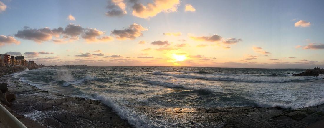 Sea Beach Sunset Nature Beauty In Nature Sky Sand Horizon Over Water Water Wave Scenics Cloud - Sky Outdoors No People Motion Tranquility Sunlight Day