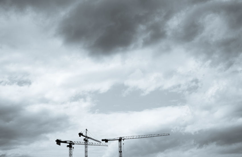Berlin is under construction...all over the city 2/2 Berlin Photography City Life Cloudy Cranes Building Exterior Cloud - Sky Crane Cranes And Construction Day Low Angle View Nature No People Outdoors Sky