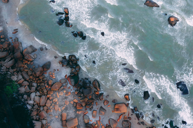 Directly above view of rocks at beach