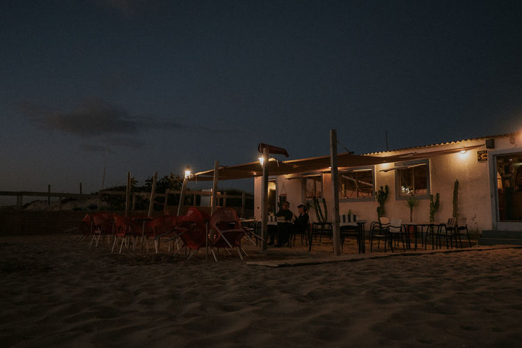 Beach Blue Hour Illuminated Nature Night No People Outdoors Restaurant Sand Sitting Outside Sky Vacations