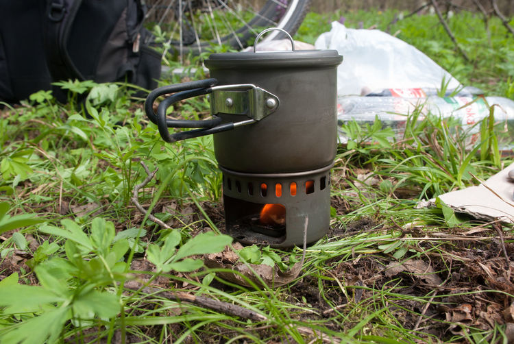Close-up of camping stove on field