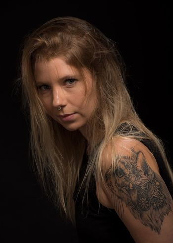 Young woman with cat tatoo Tattoo Black Background One Person Studio Shot Adult Portrait Adults Only Blond Hair People Young Adult Indoors  Studio Photography Close-up Long Hair Beautiful Woman Human Body Part Beauty AMP PICTURES