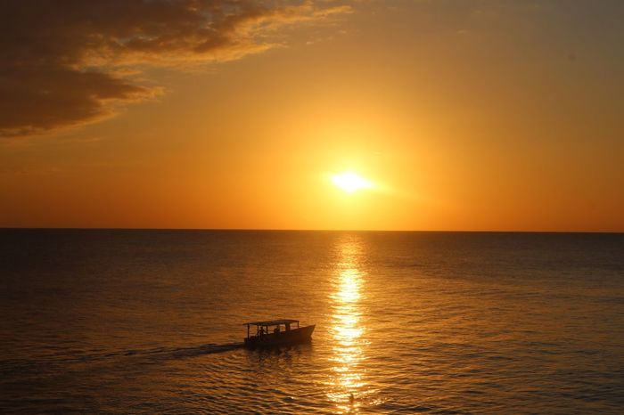 Jamaica Sunset Rickscafe Rickscafejamaica Sunset Sky Water Nautical Vessel Transportation Beauty In Nature Sea Orange Color Horizon Over Water Sun Sunlight Nature Tranquility