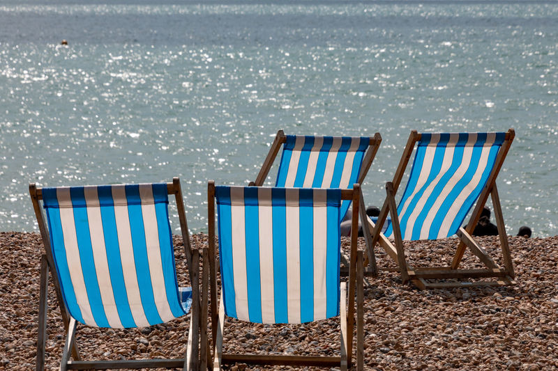 Deckchairs on beach Absence Beach Beauty In Nature Blue Chair Deck Chair Horizon Over Water Land Nature No People Outdoor Chair Outdoors Relaxation Scenics - Nature Sea Seat Striped Tranquil Scene Tranquility Trip Vacations Water
