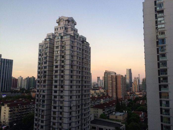 Skyscrapers In City At Dusk