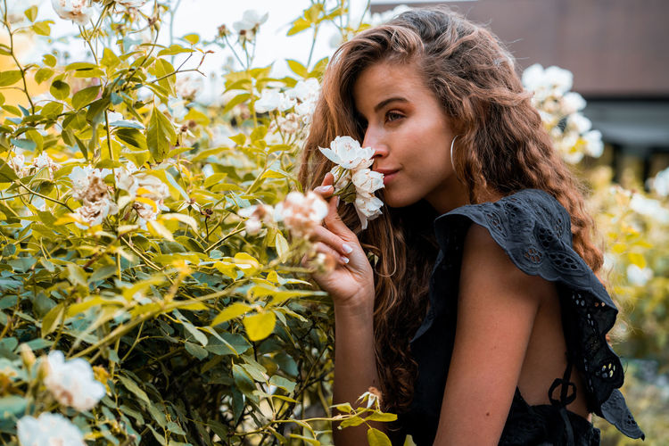Beautiful woman with pink flower