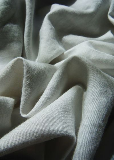 Close-Up Of Crumpled Blanket On Bed