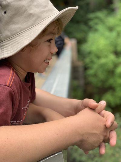 Side view of boy wearing hat