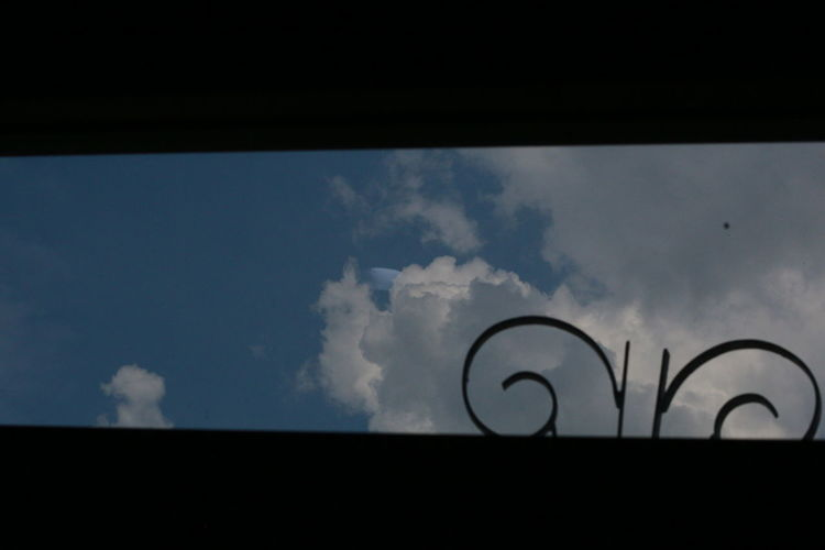 Low angle view of silhouette text against sky at sunset