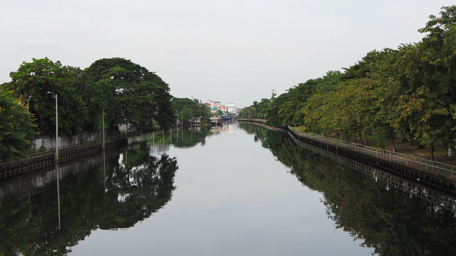darkside thailand Slum Thailand Water Reflection Tree Plant Sky Waterfront Nature Architecture Built Structure No People Tranquility Day Canal Transportation Clear Sky Outdoors Beauty In Nature Connection Diminishing Perspective