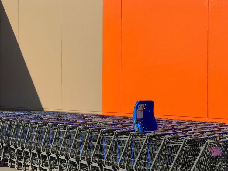The Street Photographer - 2018 EyeEm Awards The Architect - 2018 EyeEm Awards EyeEm Ready   No People Day Supermarket Modern Lines Building Exterior Minimalism Minimal Built Structure Shadow Wall Orange In A Row Orange Color Wall - Building Feature Seat Shopping Copy Space Absence Empty Chair Consumerism Order Metal Blue