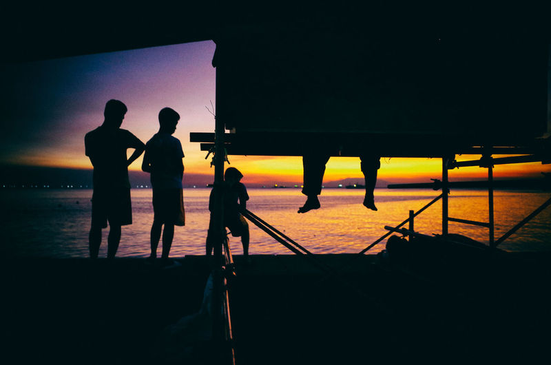 Lifestyles Men Nature People Real People Relax Sea Silhouette Standing Sunset TCPM Togetherness The Street Photographer - 2017 EyeEm Awards The Great Outdoors - 2017 EyeEm Awards