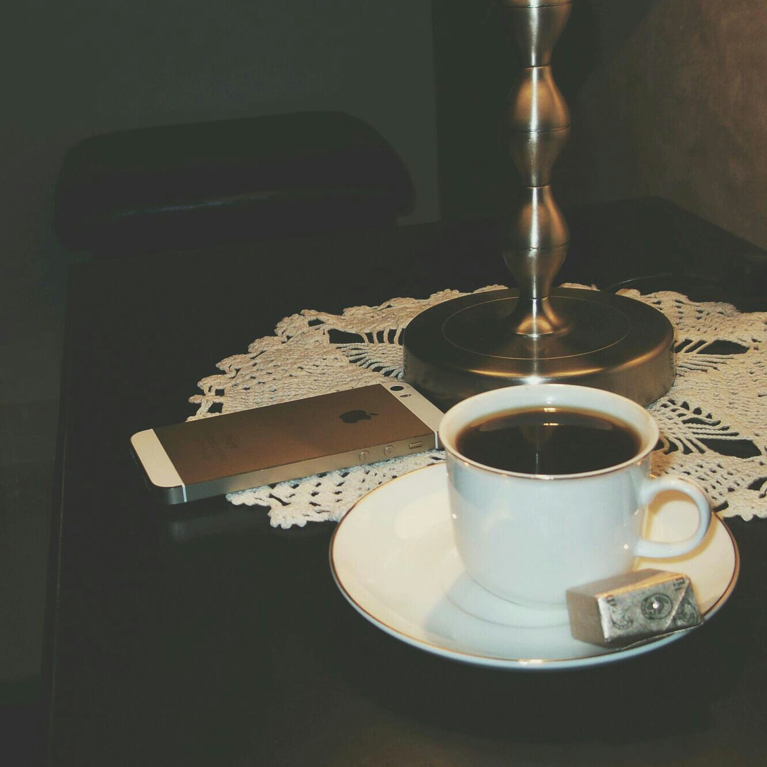 indoors, coffee cup, food and drink, table, drink, coffee - drink, still life, saucer, refreshment, cup, freshness, coffee, high angle view, spoon, plate, tea cup, close-up, no people, breakfast, frothy drink