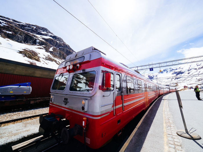 Architecture City Cold Day Mode Of Transport Mountain Norway Outdoors People Public Transportation Red Scandinavia Sky Train Train - Vehicle Transportation Wide Angle Winter