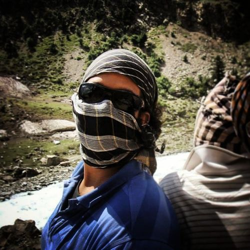 Cover your face; the elements of earth might recognize you.... Covered Face from Dust Riding on car roof hiking trekking swat valley pakistan IAmNotATerrorist tourist