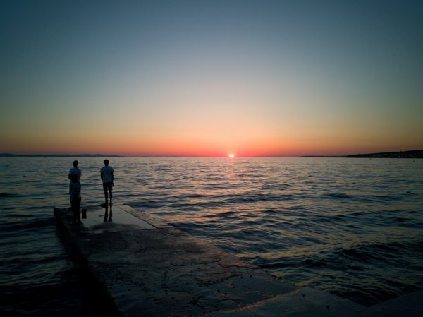 Sea Beach Sunset Silhouette Scenics Tranquil Scene Tranquility Horizon Over Water Full Length Water Two People Vacations Sky People Outdoors Travel Destinations Adult Nature Beauty In Nature Standing Huaweiphotography Croatia ❤ Zadar Sommergefühle