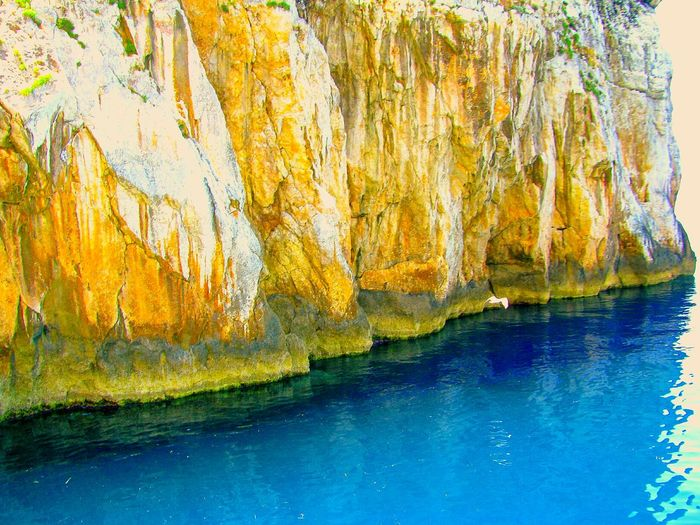 The KIOMI Collection Rock Rocks Rock Formation Cliff Steep Cliff Cliffs Rock And Sea Cliff And Sea Sea Blue Wave Blue Sea Blues Shades Of Blue Share Your Adventure Greek Islands On A Boat Water Reflections Showcase April Sea And Rocks Nature Fine Art Wallpaper Beauty In Nature Reflected Glory
