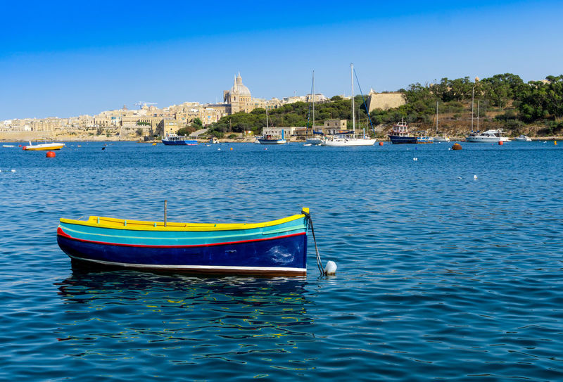 Architecture Architecture Blue Building Building Exterior Built Structure Capital Cathedral City Day Europe Malta Marsaxlokk Mediterranean  Mode Of Transport Nautical Vessel Outdoors Tourism Traditional Transportation Travel View Village Water Waterfront