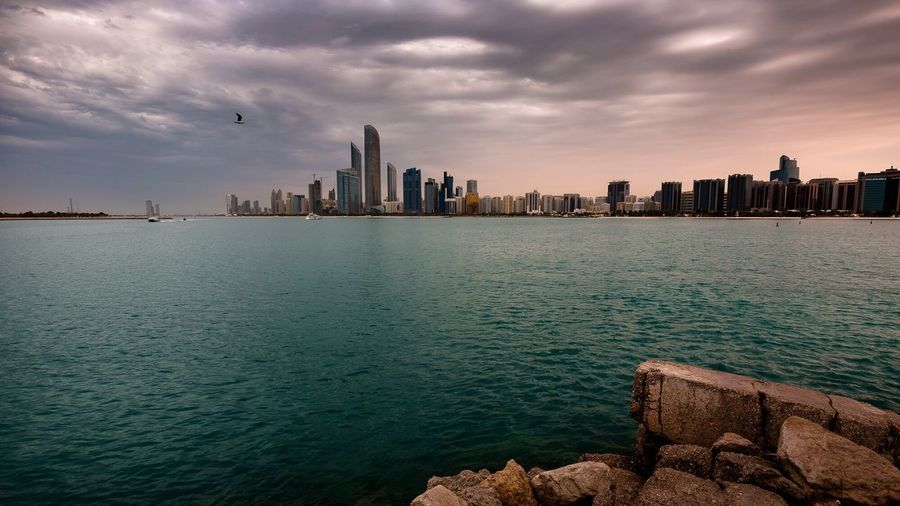City Architecture Building Exterior Skyscraper Built Structure Cityscape Sea Urban Skyline Water Sky Outdoors Cloud - Sky Residential Building No People Scenics Nature Day UAE Abudahbi abudahbi