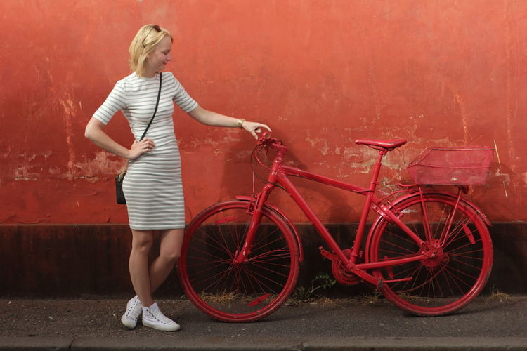 Color Contrast Full Length Full Length Portra Girl Hanging Out Model Parked Parked Bicycle Playing Around Posing Red Bicycle Red Bicycles Red Color Stripped Dre Unusual Bicycle Wall White Dress