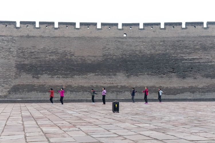 Group song-and-exercise routine outside the city wall of Pingyao China. Pingyao China People China Streetphotography Travel Documentary Storytelling Group Of People Women Real People Outdoors Lifestyles
