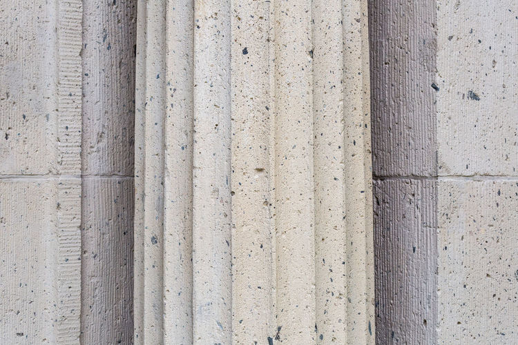 Close up of textured column at an old building Architectural Column Architectural Feature Architecture Backgrounds Building Exterior Built Structure Cemetery Close-up Concrete Concrete Wall Day Façade Full Frame Man Made Structure Outdoors Pattern Simplicity Stone Material Striped Pattern Textured  Minimalist Architecture