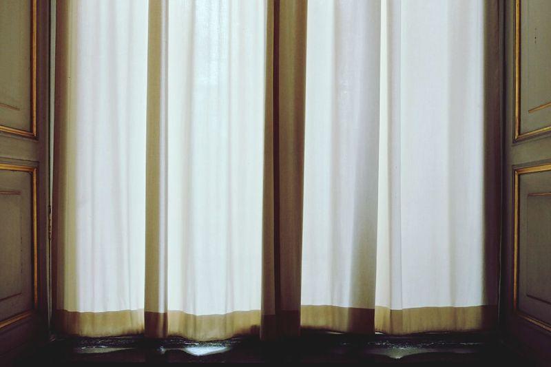 Curtain on window sill